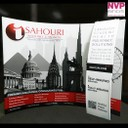 Portable display stand with stand off graphics by NVP Exhibits